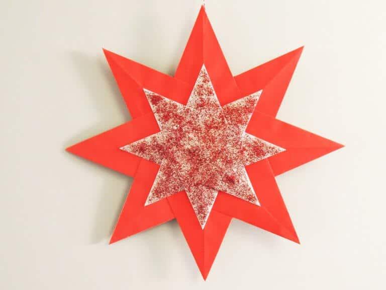 Dubbele kerstster van papier met glitter